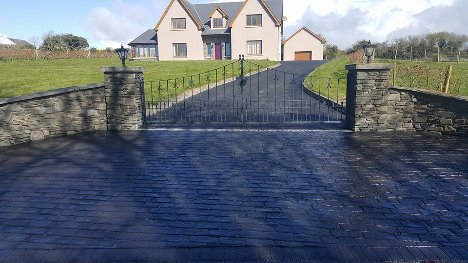 imprinted concrete and new driveway